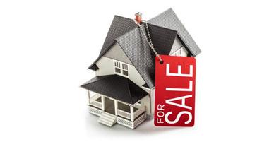 Haus mit Verkaufen Schild